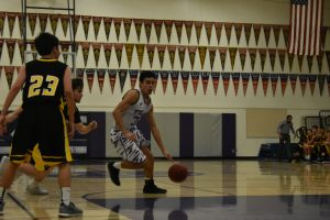 Colin Stremlau drives to the hoop
