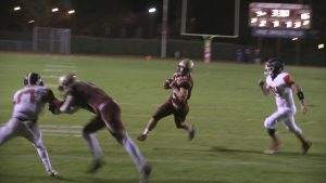 Tanner Mendoza on his way to teh end zone